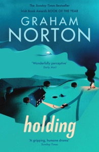 Holding Book Cover